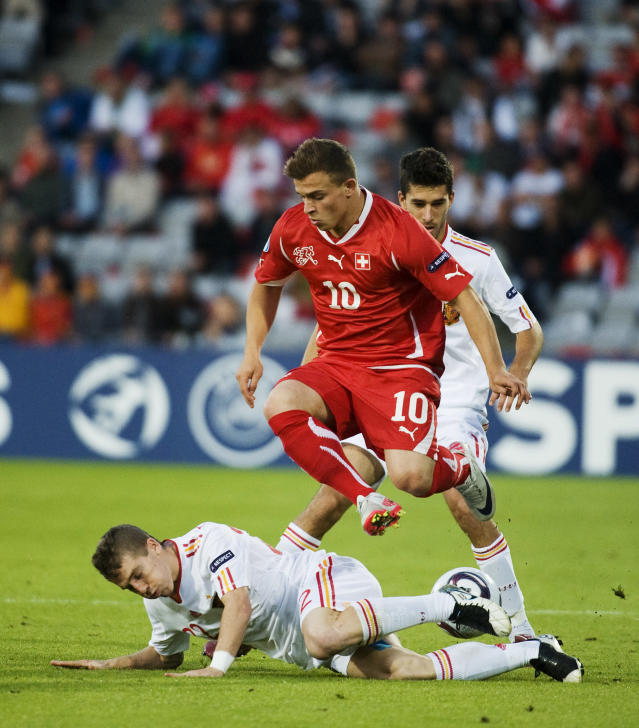 Swiss's Xherdan Shaqiri (R) vies with Spain's Iker Muniain during the UEFA Under-21 European Championship final match Spain vs Switzerland at the Aarhus Stadium, on June 25, 2011. AFP PHOTO/JONATHAN NACKSTRAND (Photo credit should read JONATHAN NACKSTRAND/AFP/Getty Images)