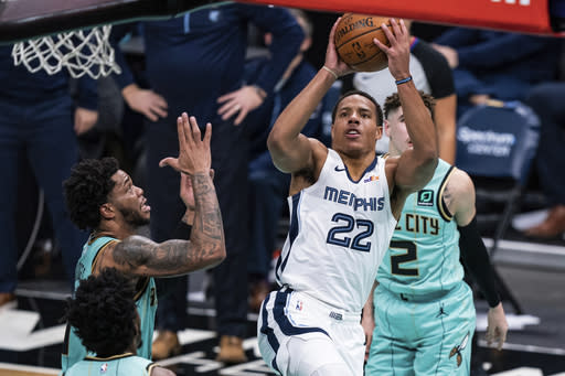 Memphis Grizzlies guard Desmond Bane (22) shoots the ball in front of Charlotte Hornets forward Miles Bridges, left, during the second half of an NBA basketball game in Charlotte, N.C., Friday, Jan. 1, 2021. (AP Photo/Jacob Kupferman)