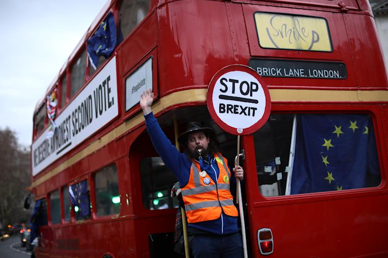 LONDON, ENGLAND - JANUARY 29: A pro-EU protester demonstrates on a bus near the Houses of Parliament on January 29, 2019 in London, England. Seven amendments to the Prime Minister's Brexit deal have been chosen for debate today including those from Dominic Grieve, Yvette Cooper and Graham Brady. MPs will begin voting on them from 7pm. (Photo by Dan Kitwood/Getty Images)