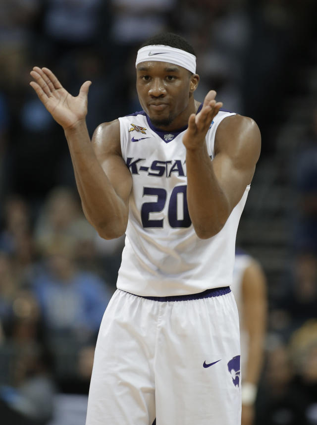 Kansas State's Xavier Sneed (20) celebrates in the waning minutes of the team's second-round game against UMBC in the NCAA men's college basketball tournament in Charlotte, N.C., Sunday, March 18, 2018. (AP Photo/Bob Leverone)