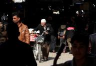 A man with a bicycle is seen in a market in Falluja