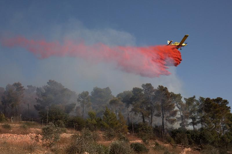 An Israeli firefighting plane helps extinguish a fire over the Halamish settlement on November 26, 2016