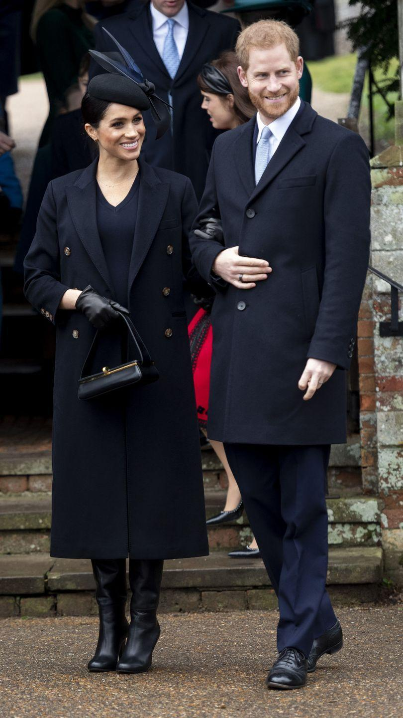 <p>Meghan Markle paired a navy dress and coat by Victoria Beckham with a feathered fascinator for the Christmas Day Church service in Sandringham. </p>