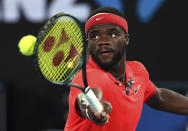 FILE - In this Tuesday, Jan. 21, 2020 file photo, Frances Tiafoe of the United States makes a backhand return to Russia's Daniil Medvedev during their first round singles match at the Australian Open tennis championship in Melbourne, Australia. Frances Tiafoe has tested positive for the coronavirus and withdrawn from the All-American Team Cup tennis tournament. Tiafoe was scheduled to face Tennys Sandgren on Saturday, July 4, 2020 in the weekend tournament involving eight top American mens players at Life Time Fitness in Peachtree Corners.(AP Photo/Lee Jin-man, File)