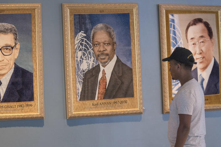 A visitor to the United Nations pauses in front of the portrait of former Secretary-General Kofi Annan at U.N. headquarters, Saturday, Aug. 18, 2018. Annan, one of the world's most celebrated diplomats and a charismatic symbol of the United Nations who rose through its ranks to become the first black African secretary-general, has died. He was 80. (AP Photo/Mary Altaffer)