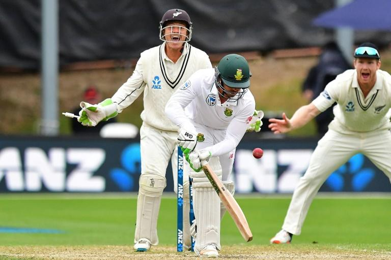 South Africa's Quinton de Kock is bowled as New Zealand's keeper BJ Watling celebrates during day four of the first Test in Dunedin