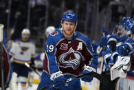 FILE - In this May 19, 2021, file photo, Colorado Avalanche center Nathan MacKinnon is congratulated at the bench after scoring his second goal of night in the third period of Game 2 of an NHL hockey Stanley Cup first-round playoff series against the St. Louis Blues in Denver. (AP Photo/David Zalubowski, File)