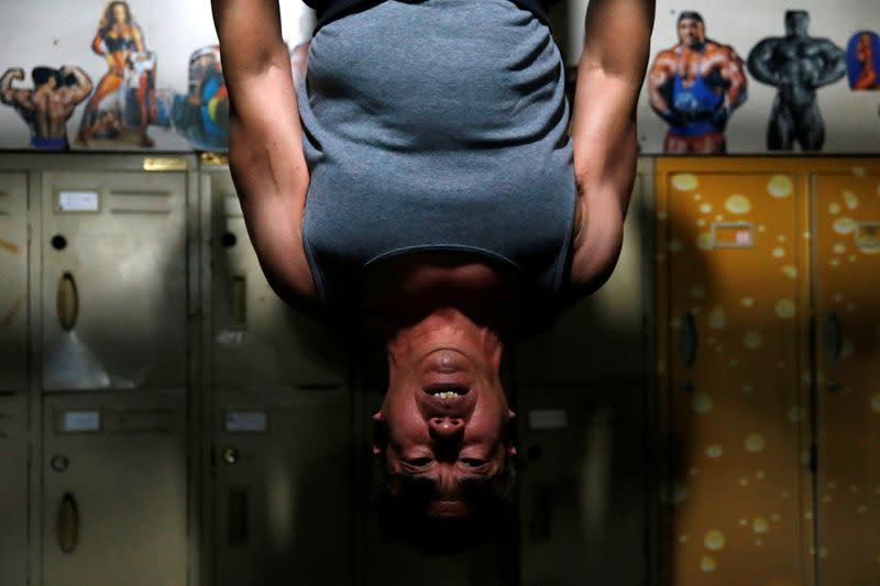 Zhao Shuyuan, 61, exercises at a gym which has been turned from a bicycle shed inside a residential compound in the southwest of Beijing