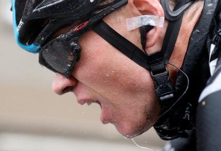 Team Sky rider Froome of Britain cycles after he fell during the 155.5 km fifth stage of the Tour de France cycling race