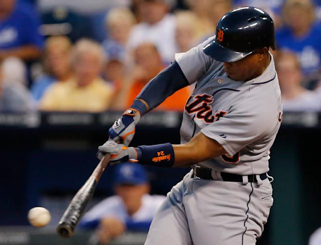 Detroit Tigers' Ramon Santiago hits an RBI-double off Kansas City Royals starting pitcher James Shields during the second inning of a baseball game at Kauffman Stadium in Kansas City, Mo., Friday, Sept. 6, 2013. (AP Photo/Orlin Wagner)