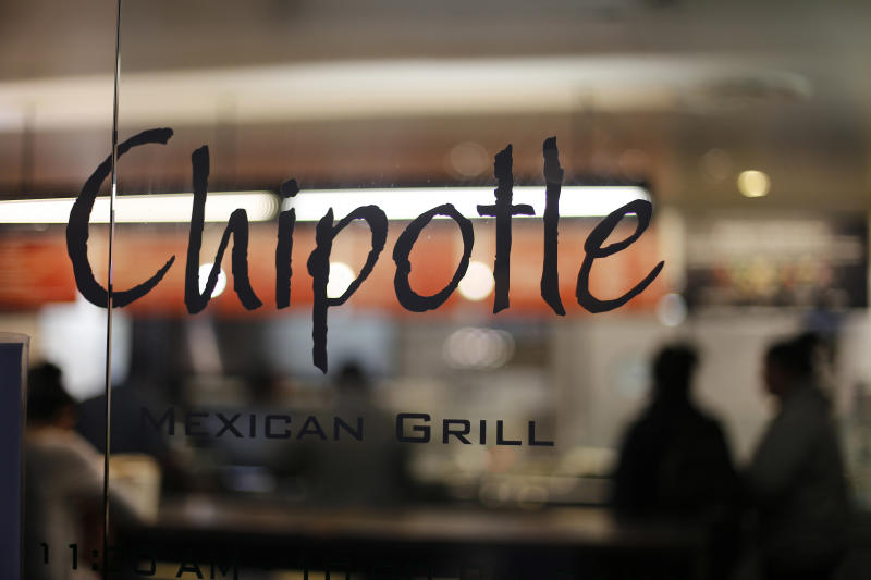 FILE - This Sunday, Dec. 27, 2015, file photo, shows a Chipotle restaurant in Union Station in Washington. Chipotle says its top marketing executive is back on the job, after being placed on leave during the summer of 2016 as a result of drug possession charges. The burrito chain says Mark Crumpacker's return was announced internally Sept. 8. Crumpacker is Chipotle's chief creative and development officer and had been in charge of the Denver company's efforts to win back customers after an E. coli outbreak last year sent sales plunging. (AP Photo/Gene J. Puskar, File)