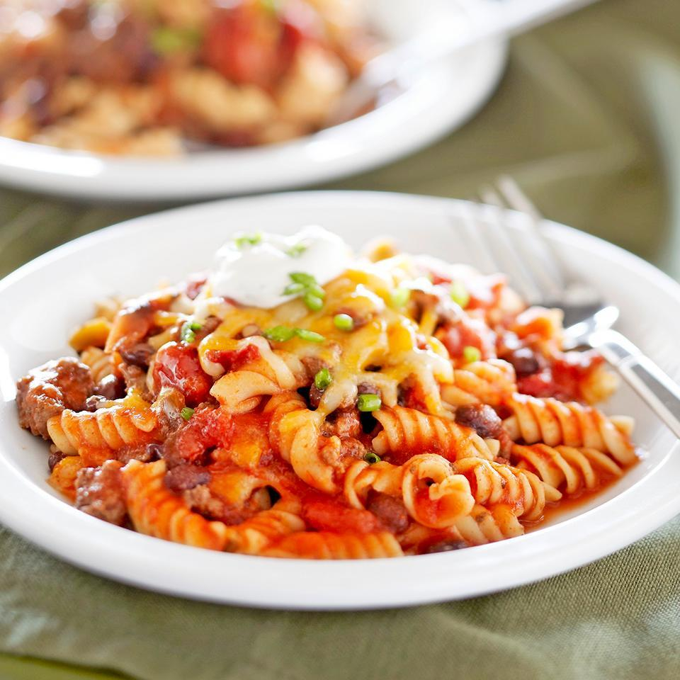 """<p>This hearty casserole features ground beef, beans, and pasta baked in a flavorful Mexican-inspired sauce and topped with cheese and sour cream. Kids will love it! <a href=""""http://www.eatingwell.com/recipe/264584/mexican-beef-bake-with-cilantro-lime-cream/"""" rel=""""nofollow noopener"""" target=""""_blank"""" data-ylk=""""slk:View recipe"""" class=""""link rapid-noclick-resp""""> View recipe </a></p>"""