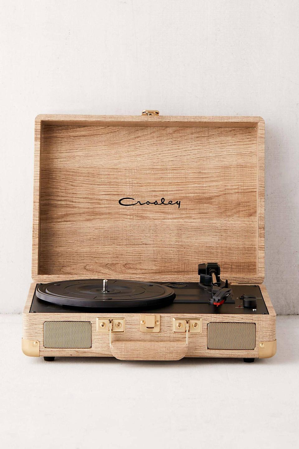 """<p><strong>Crosley</strong></p><p>urbanoutfitters.com</p><p><strong>$89.00</strong></p><p><a href=""""https://go.redirectingat.com?id=74968X1596630&url=https%3A%2F%2Fwww.urbanoutfitters.com%2Fshop%2Fcrosley-uo-exclusive-wood-cruiser-bluetooth-record-player&sref=https%3A%2F%2Fwww.seventeen.com%2Flove%2Fdating-advice%2Fg30107520%2Fone-year-anniversary-gifts-for-him-boyfriend%2F"""" rel=""""nofollow noopener"""" target=""""_blank"""" data-ylk=""""slk:Shop Now"""" class=""""link rapid-noclick-resp"""">Shop Now</a></p><p>If your boyfriend has a Spotify playlist for every situation, this record player is the perfect gift for him. Plus, it allows him to start collection vinyl albums, meaning you'll be able to gift him those for the foreseeable future.</p>"""