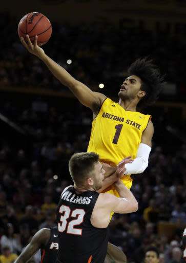 FILE - In this Dec. 22, 2017, file photo, Arizona State guard Remy Martin (1) goes to the basket against Pacific forward Jack Williams (32) in the second half of an NCAA college basketball game, in Tempe, Ariz. Arizona State broke through to the NCAA Tournament for the first time in four years last season. The Sun Devils lost key players from that team, but are building toward making it consecutive NCAA Tournaments. (AP Photo/Rick Scuteri, File)