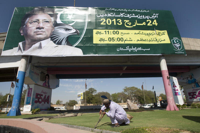 """A Pakistani gardener works under a banner of Pakistan's President Pervez Musharraf, reading """"come and join me,"""" in Karachi, Pakistan on Friday, March 22, 2013. Former Pakistani leader Musharraf vowed to return Pakistan on Sunday to take part in the coming elections in May. (AP Photo/Shakil Adil)"""