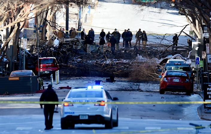 """ATF and law enforcement members investigate the Christmas Day explosion on Saturday, December 26, 2020 in Nashville, Tenn. Authorities believe an RV parked on Second Ave. caused the explosion in an """"intentional act,"""" and several blocks in downtown Nashville are sealed off as the FBI, and other local, state and federal agencies continue their investigation."""