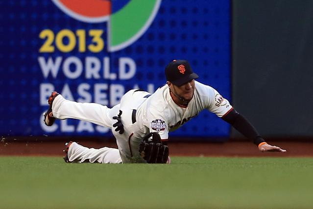 SAN FRANCISCO, CA - OCTOBER 24: Gregor Blanco #7 of the San Francisco Giants makes a diving catch in left field in the third inning during Game One of the Major League Baseball World Series at AT&T Park on October 24, 2012 in San Francisco, California. (Photo by Doug Pensinger/Getty Images)