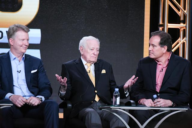 Longtime sportscaster Jack Whitaker, center, died Sunday. He was 95. (Richard Shotwell/AP)