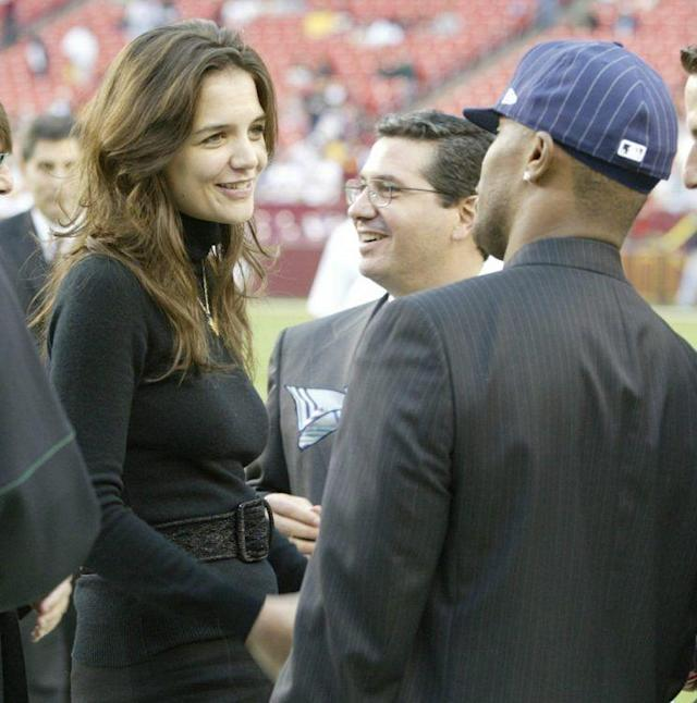 Katie Holmes and Jamie Foxx go back as far as 2006 when they were both on the sidelines of a Redskins-Vikings game. She was Tom Cruise's plus-one — and married him that year. Jamie and Tom co-starred in 2004's <i>Collateral</i>. (Photo: Win McNamee/Getty Images)