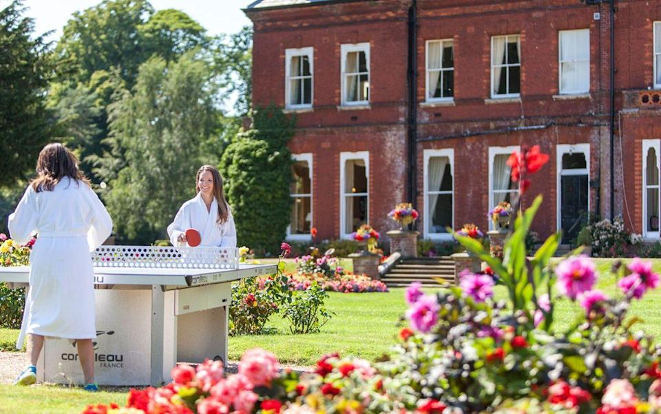 Two people playing table tennis at Champneys Tring - Steve Lancefield