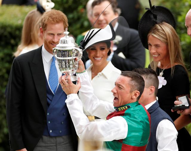 Horse Racing - Royal Ascot - Ascot Racecourse, Ascot, Britain - June 19, 2018 Frankie Dettori celebrates with a trophy after winning the 4.20 St James's Palace Stakes as Britain's Prince Harry and Meghan, the Duchess of Sussex look on Action Images via Reuters/Andrew Boyers TPX IMAGES OF THE DAY