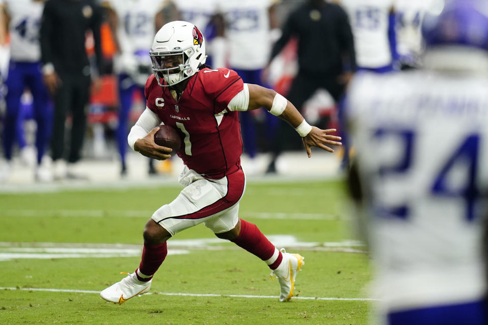 Arizona Cardinals quarterback Kyler Murray (1) runs for a touchdown against the Minnesota Vikings during the first half of an NFL football game, Sunday, Sept. 19, 2021, in Glendale, Ariz. (AP Photo/Ross D. Franklin)