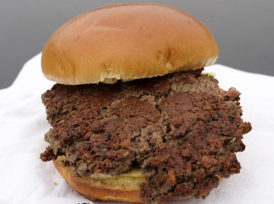 This Friday, Jan. 11, 2019 photo shows a plant-based burger made from wheat protein, coconut oil, potato protein and other ingredients in Bellevue, Neb. Released on Wednesday, Jan. 16, 2019, a report from a panel of nutrition, agriculture and environmental experts recommends a plant-based diet, based on previously published studies that have linked red meat to increased risk of health problems. (AP Photo/Nati Harnik)