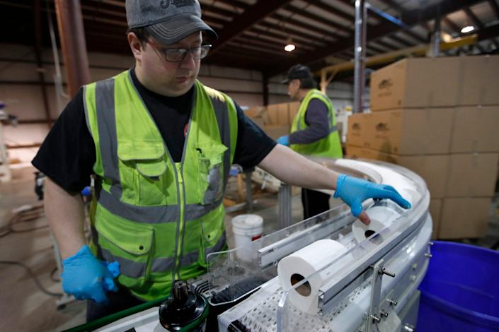 A worker at the Tissue Plus factory on March 18 in Bangor, Maine.