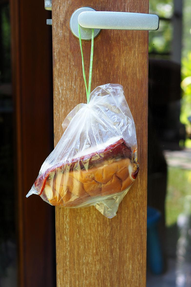 You can hang the plastic bag with your sandwich in your car or at home.