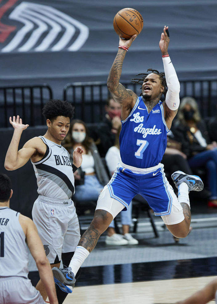 Los Angeles Lakers guard Ben McLemore, right, shoots over Portland Trail Blazers guard Anfernee Simons during the first half of an NBA basketball game in Portland, Ore., Friday, May 7, 2021. (AP Photo/Craig Mitchelldyer)