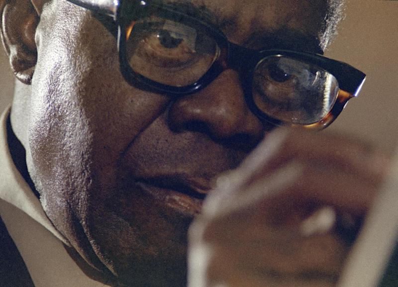 FILE -- In a 1970 file photo Louis Armstrong is seen during a recording session in New York. A live recording of Louis Armstrong playing his trumpet for one of the last times is being played Friday April 27, 2012 at the National Press Club in Washington where it was created in January 1971. (AP Photo/Eddie Adams, file)