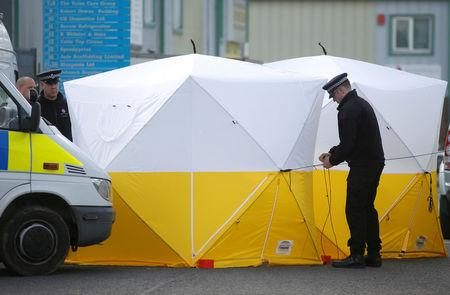 Police officers erect a forensic tent at a car recovery depot in Norton Enterprise Park, where Sergei Skripal's car was originally transported, in Salisbury, Britain, March 13, 2018. REUTERS/Henry Nicholls