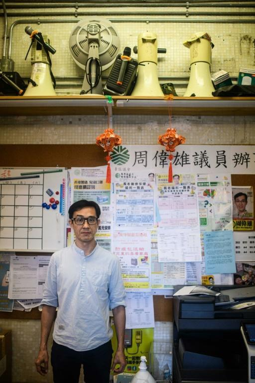 Hong Kong district councillor Chow Wai-hung was arrested under the city's new security law after he raised placards at a protest in late July