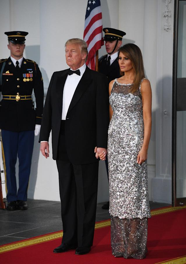 <p>For her debut state dinner at the White House, Melania Trump donned a sheer-effect dress hot from the runway. Perhaps a subtle tribute to French guests Emmanuel and Brigitte Macron, the First Lady donned a Chanel haute couture gown. Meanwhile, Brigitte opted for custom Louis Vuitton. <em>[Photo: Getty]</em> </p>