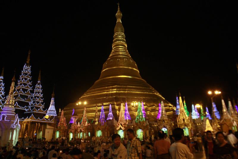 Buddhist devotees prepare to cerebrate the 2,600 anniversary of Myanmar's land mark Shwedagon Pagoda's establishment in Yangon, Myanmar Tuesday, Feb. 21, 2012. Vast crowds were gathering Wednesday at Myanmar's most sacred Buddhist shrine to celebrate a festival banned for more than 20 years under the former military government. (AP Photo/Khin Maung Win)
