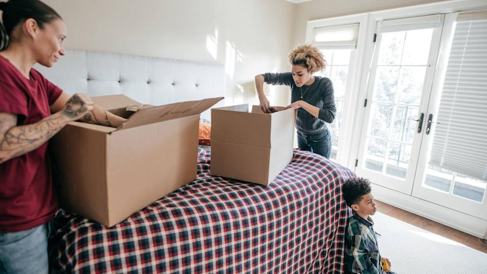 family filling boxes to move items out of house