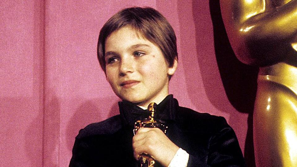 Tatum O'Neal with her Oscar in 1974 - Credit: Courtesy of Richard Markell/Everett Collection