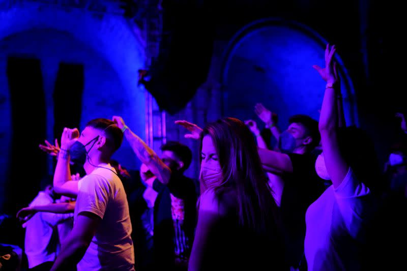 Clubbers hit dance floor again as Spain trials digital COVID-19 pass