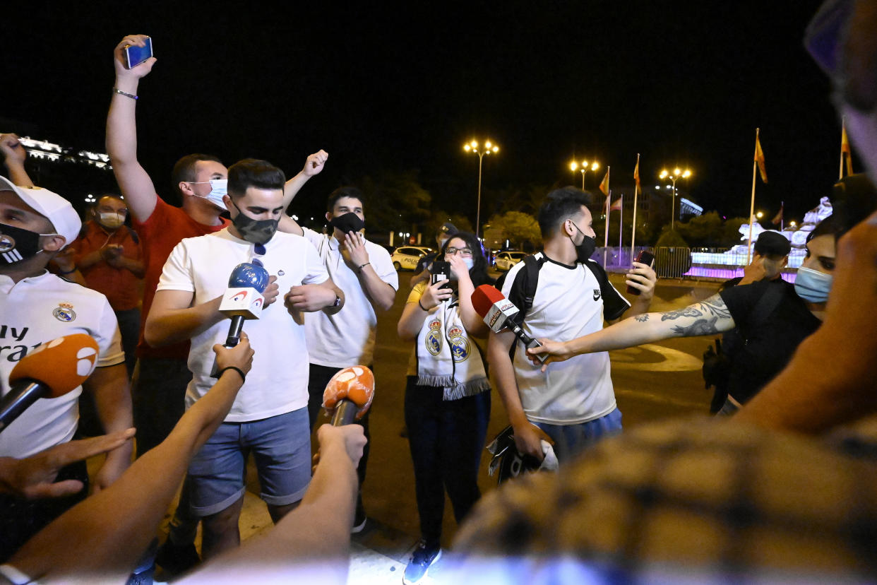 A Real Madrid fans celebrate front of La Cibeles fountain after Real Madrid won La Liga championship in downtown Madrid, Spain, on July 16, 2020. Real Madrid and local authorities asked the supporters not to celebrate the title around the fountain to avoid a new COVID-19 outbreak. Real Madrid got its 34th Spanish Championship after defeating Villarreal (Photo by Oscar Gonzalez/NurPhoto via Getty Images)