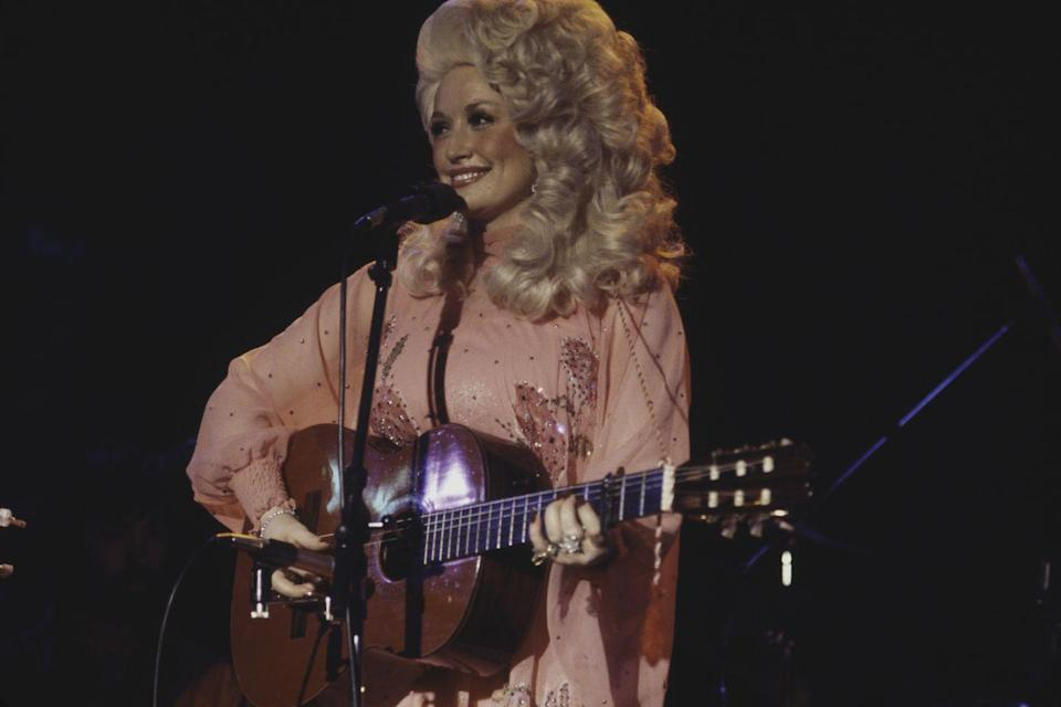 <p>While performing at a Windows on the World in New York City in the '70s, Dolly is a vision in a flowing, pink gown with sequin embellishments.</p>