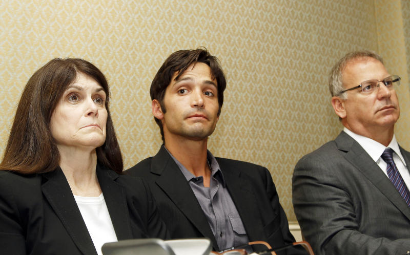 FILE - In this Monday, April 21, 2014 file photo, plaintiff Michael Egan III, center, 31, his mother Bonnie Mound, left, and attorney Jeff Herman take questions from the media during a news conference in Beverly Hills, Calif. A theater producer sued on Monday by Egan accusing several Hollywood figures of sexual assault is denying the man's claims or that he was in Hawaii when the alleged abuse happened. Attorneys for Gary Goddard wrote in a statement Wednesday, April 23, 2014, denying that the theater producer molested or gave drugs or alcohol to Egan. (AP Photo/Nick Ut, file )