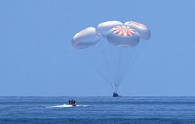 A SpaceX capsule splashes down Sunday, August 2, 2020, in the Gulf of Mexico. Astronauts Doug Hurley and Bob Behnken spent a little over two months on the International Space Station. It was the first splashdown in 45 years for NASA astronauts and the first time a private company has ferried people from orbit. / Credit: NASA