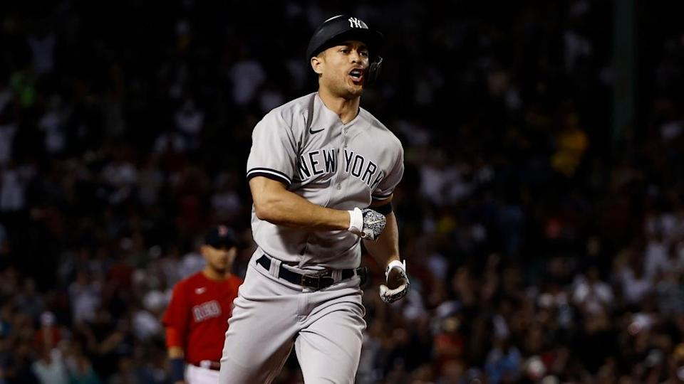 Giancarlo Stanton fired up rounding bases grand slam road uniform Red Sox visible