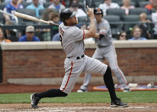 San Francisco Giants' Hunter Pence hits a third-inning, two-run home run off New York Mets starting pitcher Bartolo Colon in a baseball game in New York, Sunday, Aug. 3, 2014. (AP Photo/Kathy Willens)