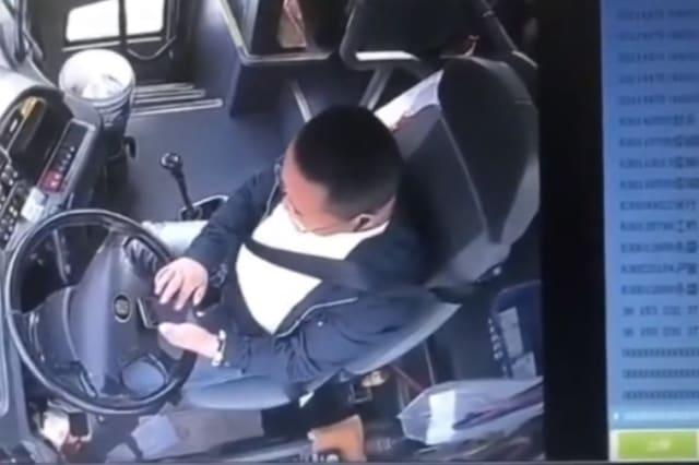 Bus carrying passengers rear-ends truck on Chinese highway as driver plays on phone while driving