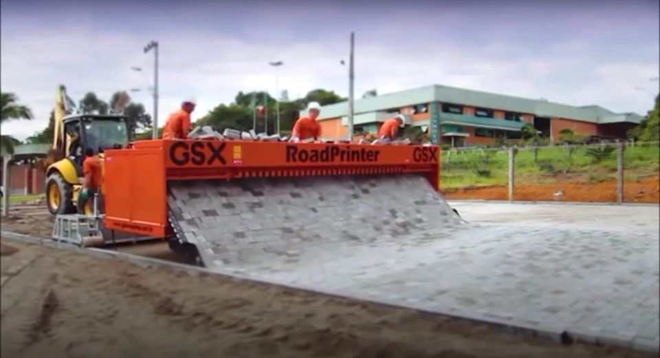 These brick-laying machines semi-automatically roll out roads in a deeply satisfying way.