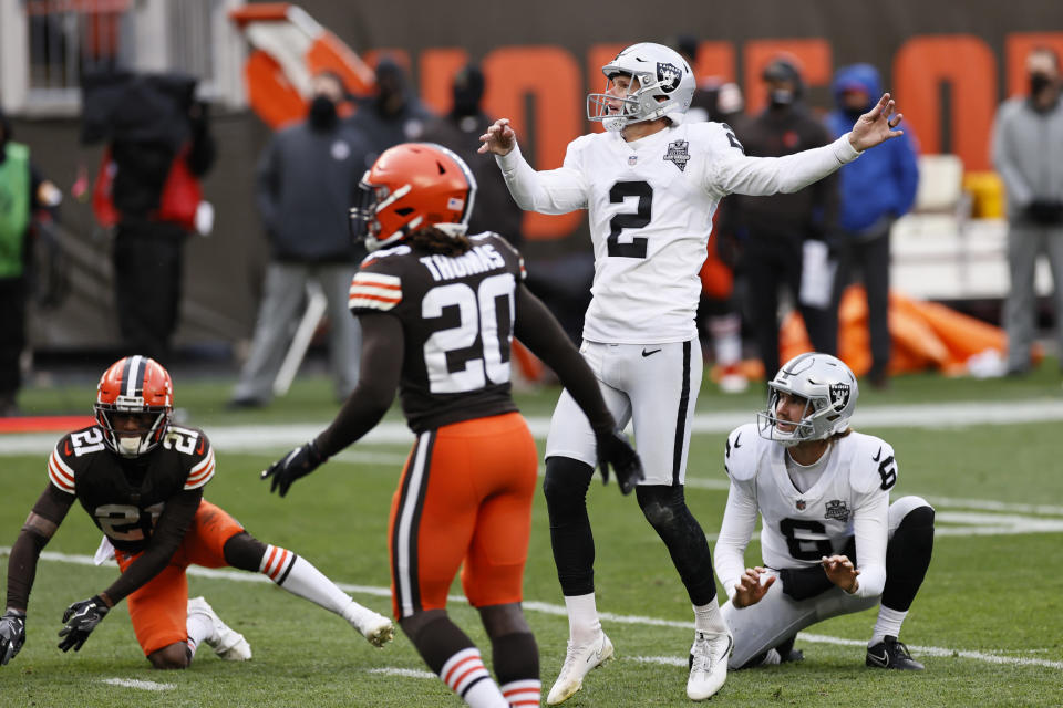 Las Vegas Raiders kicker Daniel Carlson (2) watches the ball after kicking a 24-yard field goal during the second half of an NFL football game against the Cleveland Browns, Sunday, Nov. 1, 2020, in Cleveland. The Raiders won 16-6. (AP Photo/Ron Schwane)