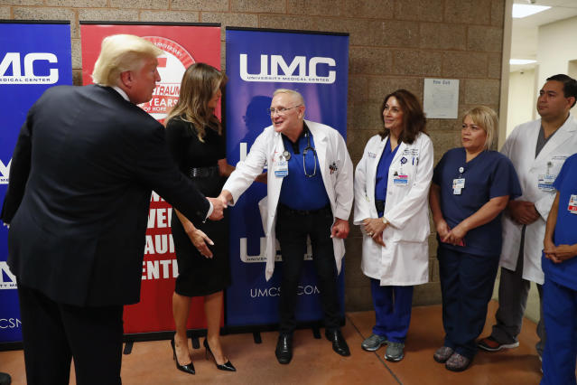 <p>President Donald Trump, with first lady Melania Trump, greets trauma center staff at the University Medical Center after meeting with victims in the wake of the mass shooting in Las Vegas, Nev., Oct. 4, 2017. (Photo: Kevin Lamarque/Reuters) </p>