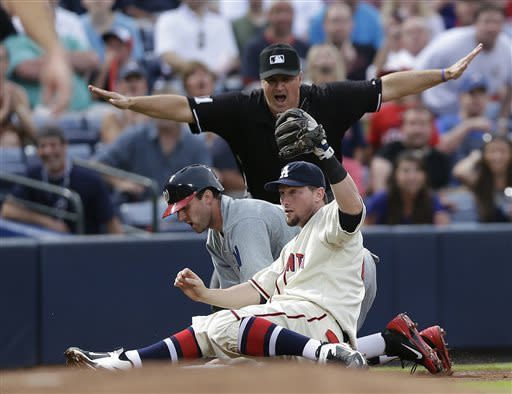 Washington Nationals' Stephen Lombardozzi (1) is called safe at third base by umpire Tony Randazzo as Atlanta Braves third baseman Chris Johnson holds up the ball during the fourth inning of a baseball game in Atlanta, Saturday, June 1, 2013. (AP Photo/John Bazemore)