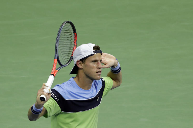 Diego Schwartzman, of Argentina, asks for cheers from the spectators after winning a point against Rafael Nadal, of Spain, during the quarterfinals of the U.S. Open tennis tournament Wednesday, Sept. 4, 2019, in New York. (AP Photo/Adam Hunger)